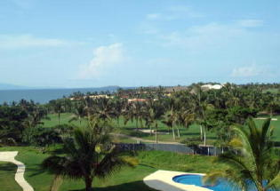Beautiful view of Pacific Ocean, pool and golf course from terrace.