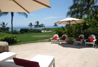 Private sand beach and view of golf course and Bay.