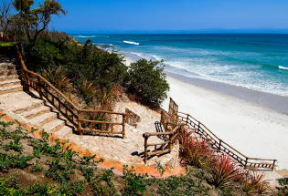 Private stairway leading to white sand beach.