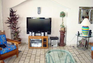 Large sc reen TV and entertainment center.