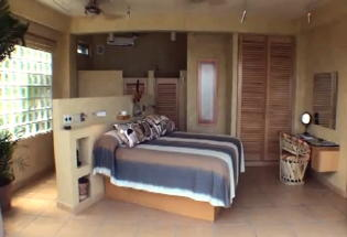 Guest bedroom with private bath and views of Bay.