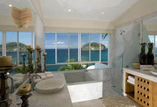 Master Bath with Jacuzzi and View of ocean.