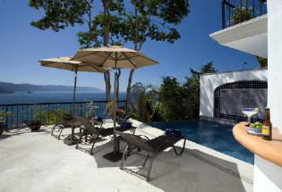 Pool terrace with view of Banderas Bay.