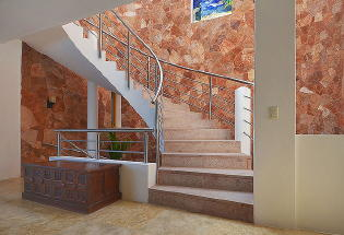 Staircase to upper bedrooms from main living level.