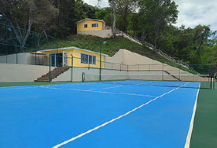 View from tennis court showing gym and casita.